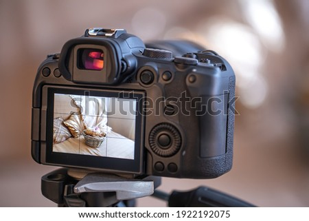 Close up professional digital camera on a blurred background. The concept of technology for working with photos and videos.