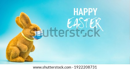 Happy Easter day holiday.Rabbit in easter with mask medical during coronavirus covid19.Bunny eggs around rabbit.Healthcare, Holiday, Mask stay safe.Spring season.Happy easter banner blue background.
