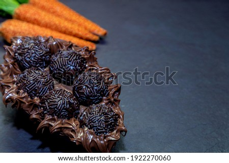 Brigadeiro chocolate easter egg in black stone background with copy space Royalty-Free Stock Photo #1922270060