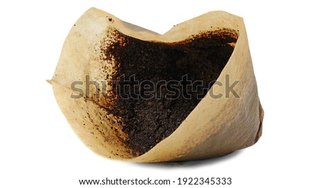 Used ground coffee in a filter isolated on white background, side view. Royalty-Free Stock Photo #1922345333