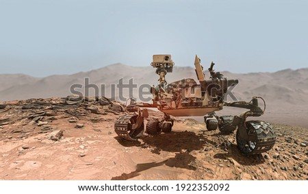Rover on Mars surface. Exploration of red planet. Space station expedition. Perseverance. Expedition of Curiosity. Elements of this image furnished by NASA Royalty-Free Stock Photo #1922352092