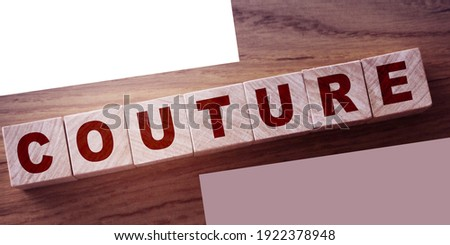 Couture Word Written In Wooden Cube. Fashion style design business concept.
