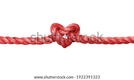 Rope with a heart shaped knot isolated on white background Royalty-Free Stock Photo #1922391323