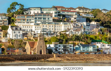 Saint Aubin town seashore view with Sacred heart of Jesus church,, bailiwick of Jersey, Channel Islands Royalty-Free Stock Photo #1922393393