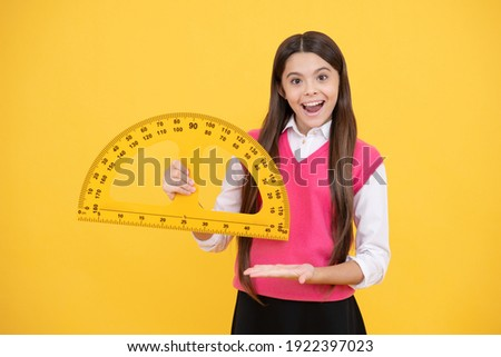 try this. child with protractor. angle degree measurement surprised teen girl hold ruler. back to school. algebra and geometry. kid study math. stem disciplines. concept of education.