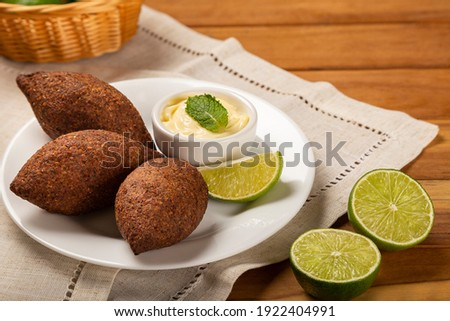 Kibbeh - The traditional Arabian snack, known in Brazil as Quibe. Royalty-Free Stock Photo #1922404991