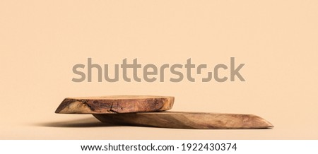 Rustic wood pieces podium. Background for perfume, jewellery and cosmetic products. Front view. Royalty-Free Stock Photo #1922430374