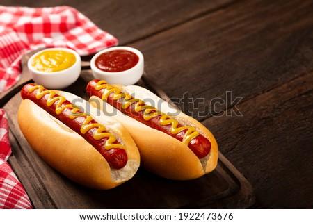 Hot dog with ketchup and yellow mustard. Royalty-Free Stock Photo #1922473676