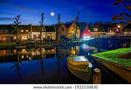 River town in evening scene. Holland evening river town. River boat evening town. Evening river town view Royalty-Free Stock Photo #1922550830