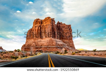 Red rock canyon desert highway road landscape. Highway road in red rock canyon desert. Desert highway road in red rock canyon. Red rock canyon road view Royalty-Free Stock Photo #1922550869