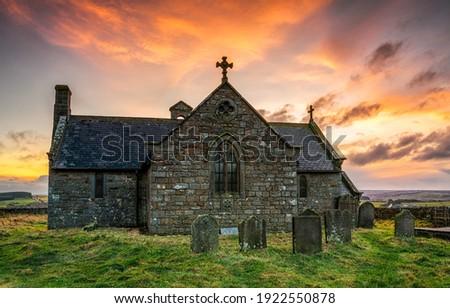 Old stone church at sunrise. Stone church cemetary. Ancient old stone church view. Church cemetery Royalty-Free Stock Photo #1922550878