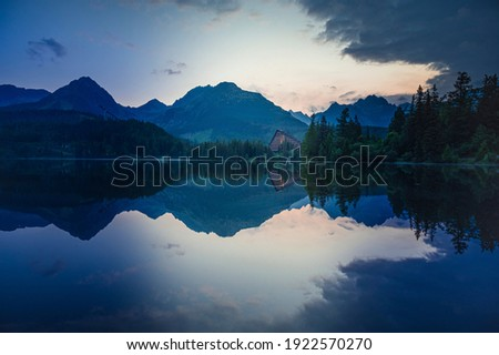 Majestic mountain lake in National Park High Tatras National Park, Slovakia, Europe. Sunset. Royalty-Free Stock Photo #1922570270