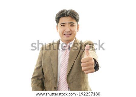 Smiling businessman with thumbs up #192257180