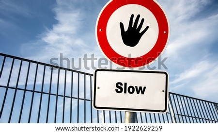 Street Sign the Direction Way to Fast versus Slow Royalty-Free Stock Photo #1922629259