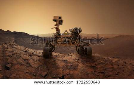 Mars 2020 Perseverance Rover is exploring surface of Mars. Perseverance rover Mission Mars exploration of red planet. Space exploration, science concept. .Elements of this image furnished by NASA. Royalty-Free Stock Photo #1922650643