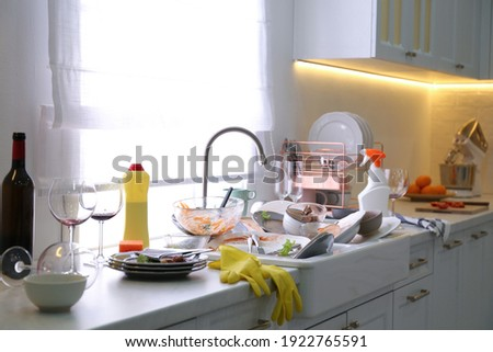 Dirty dishes in kitchen after new year party Royalty-Free Stock Photo #1922765591