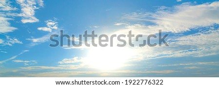 The morning sky looked like a bright golden sky. The sunrise is decorated with clouds in various shapes. Looks beautiful. Royalty-Free Stock Photo #1922776322