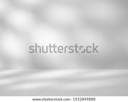 Gray background for product presentation with shadows sunlight Royalty-Free Stock Photo #1922849888