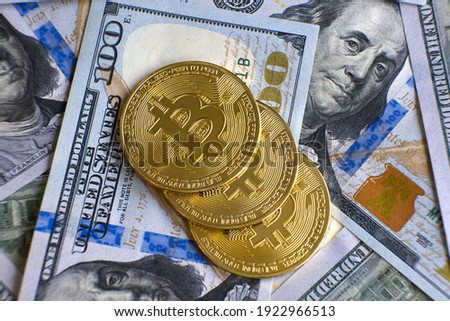 Close up of metal shiny bitcoin crypto currency coins on US dollar bills. Electronic decentralized money concept. Royalty-Free Stock Photo #1922966513