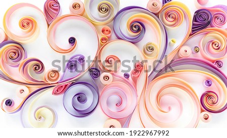 Quilling paper art background. Abstract pattern of curls and rolls of cut colored paper. Filigree paper hobby. Floral pattern in pink and purple tones. Royalty-Free Stock Photo #1922967992