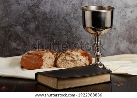 holy communion chalice with wine and bread. Royalty-Free Stock Photo #1922988836