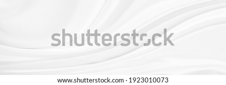 Black gray satin dark fabric texture luxurious shiny that is abstract silk cloth background with patterns soft waves blur beautiful. Royalty-Free Stock Photo #1923010073