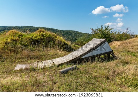 Wooden jumping platform for biking in nature. Entry only for experienced cyclists stock photo. Sports ramp for bicycle.