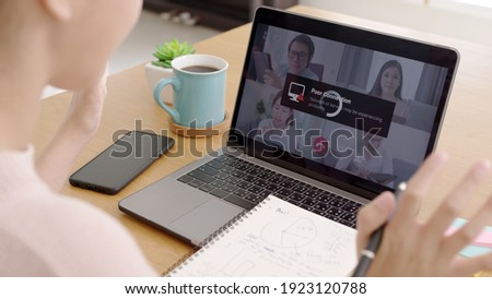 Back rear view young asian woman employee work from home using computer notebook videocall meeting conference angry annoy with low poor unreliable internet wifi connection problem issue outage. Royalty-Free Stock Photo #1923120788