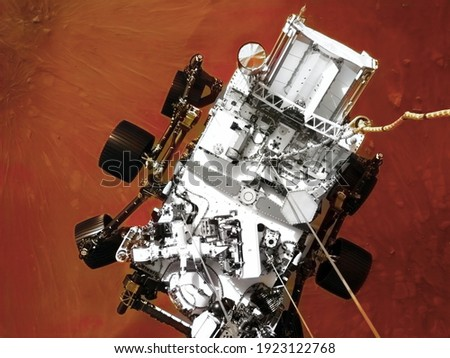 Mars 2020 Perseverance Rover is exploring surface of Mars. Perseverance rover Mission Mars exploration of red planet. Space exploration, science concept. .Elements of this image furnished by NASA. Royalty-Free Stock Photo #1923122768