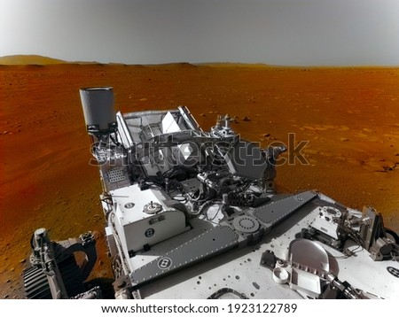 Mars 2020 Perseverance Rover is exploring surface of Mars. Perseverance rover Mission Mars exploration of red planet. Space exploration, science concept. .Elements of this image furnished by NASA. Royalty-Free Stock Photo #1923122789