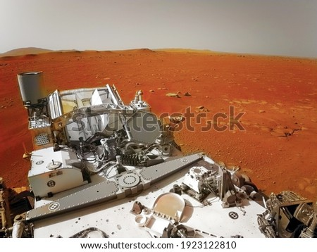 Mars 2020 Perseverance Rover is exploring surface of Mars. Perseverance rover Mission Mars exploration of red planet. Space exploration, science concept. .Elements of this image furnished by NASA. Royalty-Free Stock Photo #1923122810