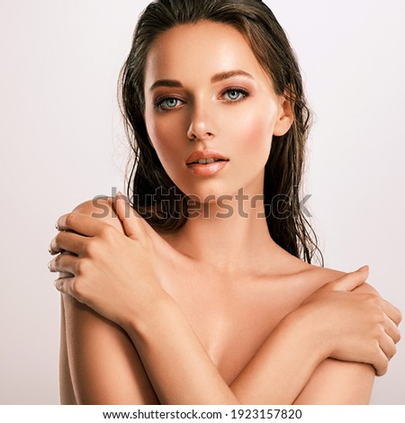 Closeup  portrait of an attractive caucasian girl with wet hair. Model with bright brown eye makeup. Skin care concept.  Young beautiful woman with healthy skin of face.  Royalty-Free Stock Photo #1923157820