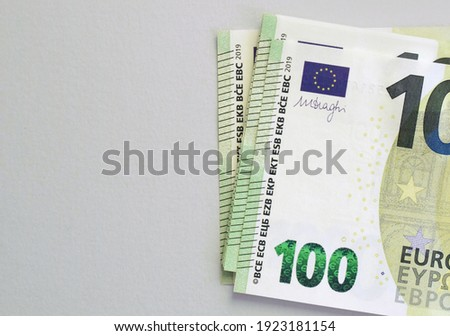 100 euro banknotes on grey background. European currency Royalty-Free Stock Photo #1923181154