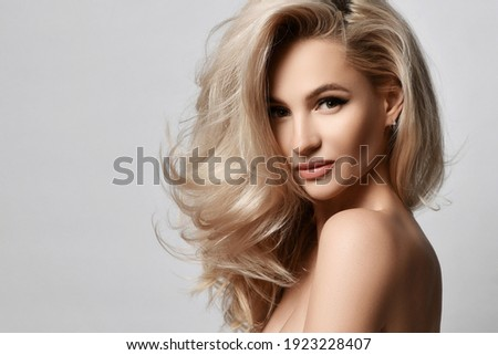 Healthy skin beautiful woman beauty skin and hair portrait natural make up. Blonde woman face clean healthy skin natural female spa glamour portrait on grey background Royalty-Free Stock Photo #1923228407