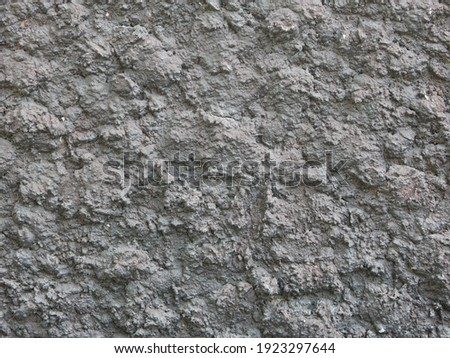 wall rough building cement stone pattern background  Royalty-Free Stock Photo #1923297644