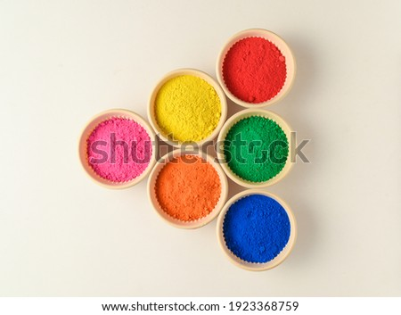 top view of colorful traditional holi powder in bowls isolated on white background.Space for text . happy holi.Concept Indian color festival called Holi Royalty-Free Stock Photo #1923368759
