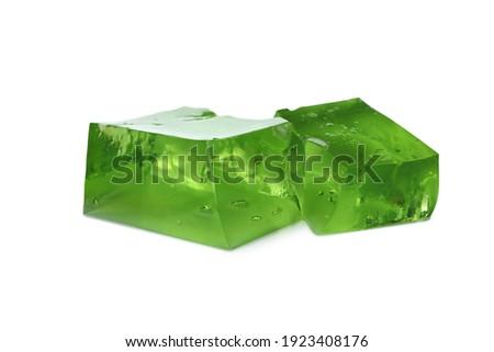 Cubes of kiwi jelly isolated on white background Royalty-Free Stock Photo #1923408176