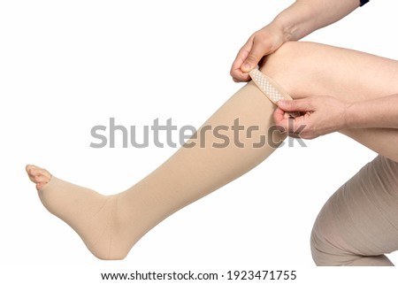 Compression garments for the treatment of lipoedema and lymphoedema.Lymphedema management: Wrapping leg using multilayer bandages to control Lymphedema. Part of complete decongestive therapy (cdt Royalty-Free Stock Photo #1923471755