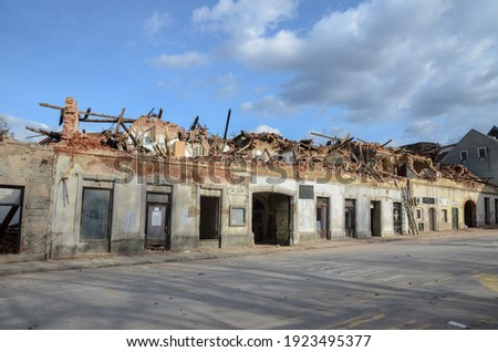 Strong earthquake hit Croatia. Damaged buildings in Petrinja. Ruined buildings damaged by an earthquake.   Royalty-Free Stock Photo #1923495377