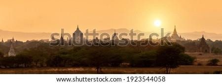 Panorama of temples silhouettes in Bagan at sunset, Burma, Myanmar Royalty-Free Stock Photo #1923544058