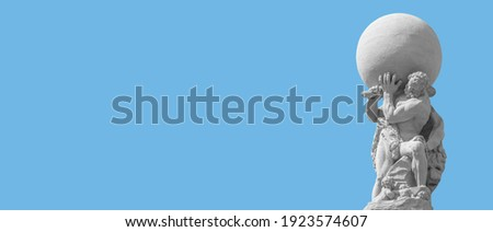 Banner with an old statue of powerful Heracles aka Atlas of Renaissance Era holding a globe, Earth at his shoulders in Dresden historical downtown with copy space and blue sky background, Germany Royalty-Free Stock Photo #1923574607