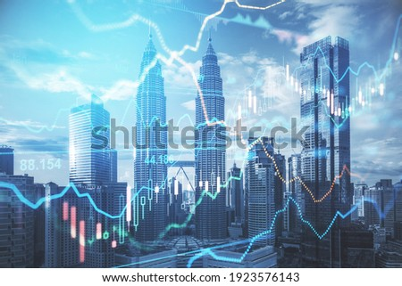 Stock market business concept with financial chart with diagram and graphs at megapolis city background. Double exposure Royalty-Free Stock Photo #1923576143