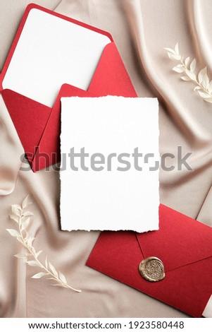 Luxury wedding invitation card mockup and envelopes on beige silk. Flat lay, top view, copy space. Elegant wedding stationery set. Royalty-Free Stock Photo #1923580448