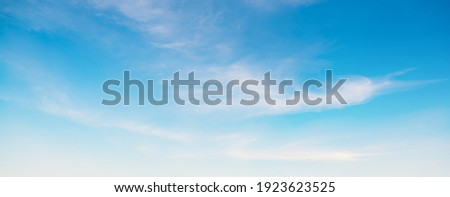 Blue sky and white clouds floated in the sky on a clear day with warm sunshine combined with cool breeze blowing against the body resulting in a miraculous refreshing like paradise Royalty-Free Stock Photo #1923623525