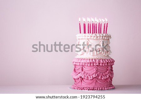 Ornate vintage buttercream birthday cake with buttercream ruffles and frills Royalty-Free Stock Photo #1923794255