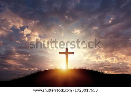 Holy concept: Silhouette wooden cross on  mountain sunset background Royalty-Free Stock Photo #1923819653