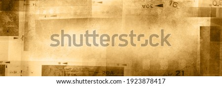 Film negative frames brown background. Copy space Royalty-Free Stock Photo #1923878417
