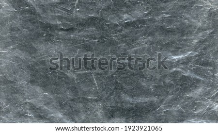 White scratches and dust on black background. Vintage scratched grunge plastic texture. Scratched glass surface wallpaper. Space for text Royalty-Free Stock Photo #1923921065