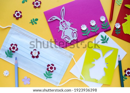 Easter holidays in quarantine. classes with children. making an Easter card. medical mask and school supplies
