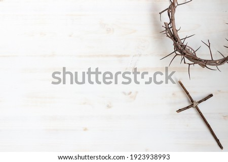 Crown of thorns with wood cross on white background with copy space Royalty-Free Stock Photo #1923938993